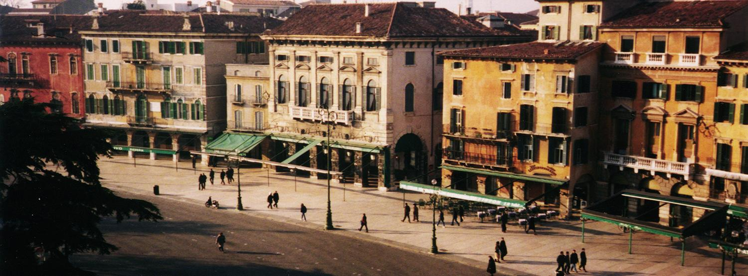 An Italian pedestrian scene with older buildings.
