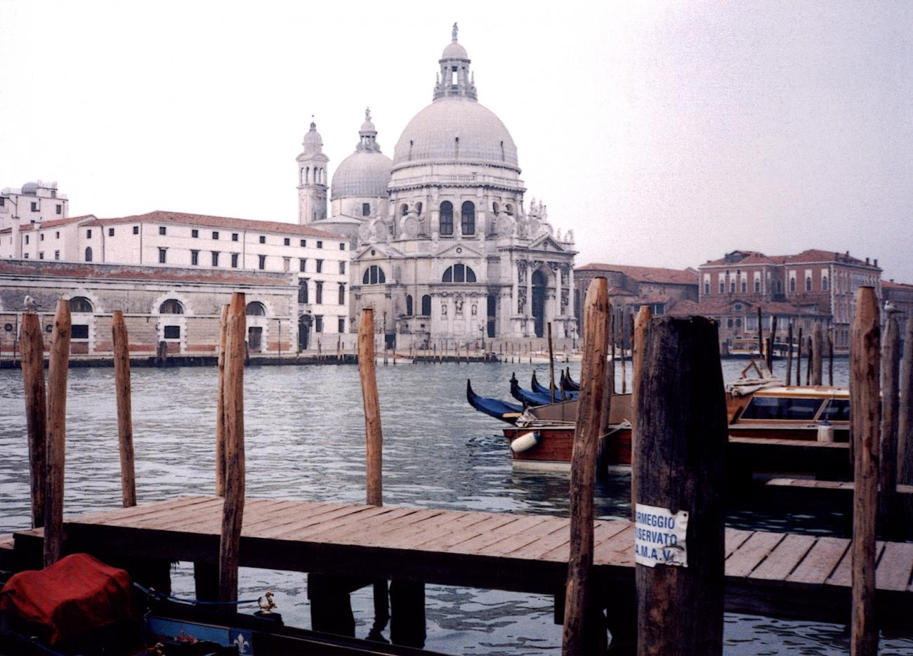 Docks in Venice with basilica in background.